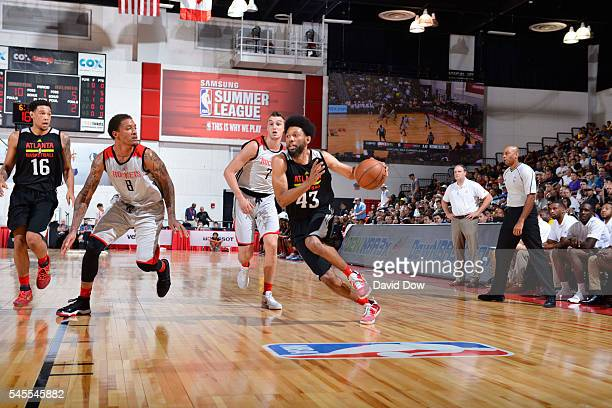DeAndre' Bembry of the Atlanta Hawks handles the ball against the Houston Rockets during the 2016 NBA Las Vegas Summer League game on July 8 2016 at...
