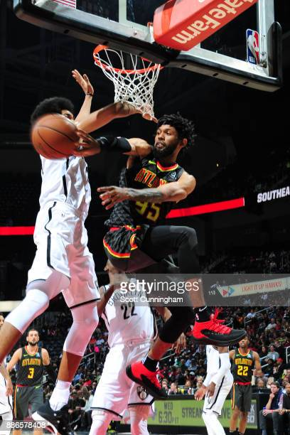 DeAndre' Bembry of the Atlanta Hawks passes the ball against the Brooklyn Nets on December 4 2017 at Philips Arena in Atlanta Georgia NOTE TO USER...