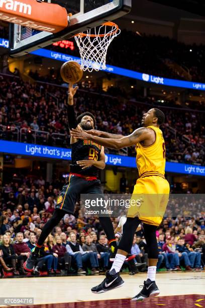 DeAndre' Bembry of the Atlanta Hawks shoots over Channing Frye of the Cleveland Cavaliers during the second half at Quicken Loans Arena on April 7...
