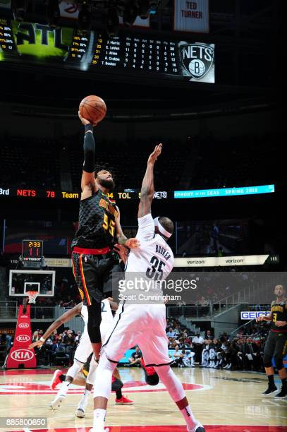 DeAndre' Bembry of the Atlanta Hawks shoots the ball against the Brooklyn Nets on December 4 2017 at Philips Arena in Atlanta Georgia NOTE TO USER...