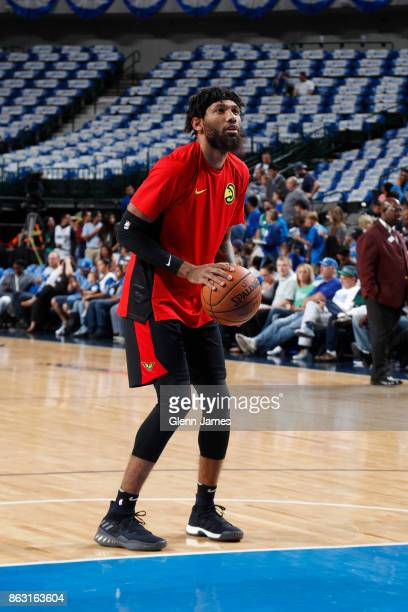 DeAndre' Bembry of the Atlanta Hawks warms up before the game against the Dallas Mavericks at the American Airlines Center in Dallas Texas on October...