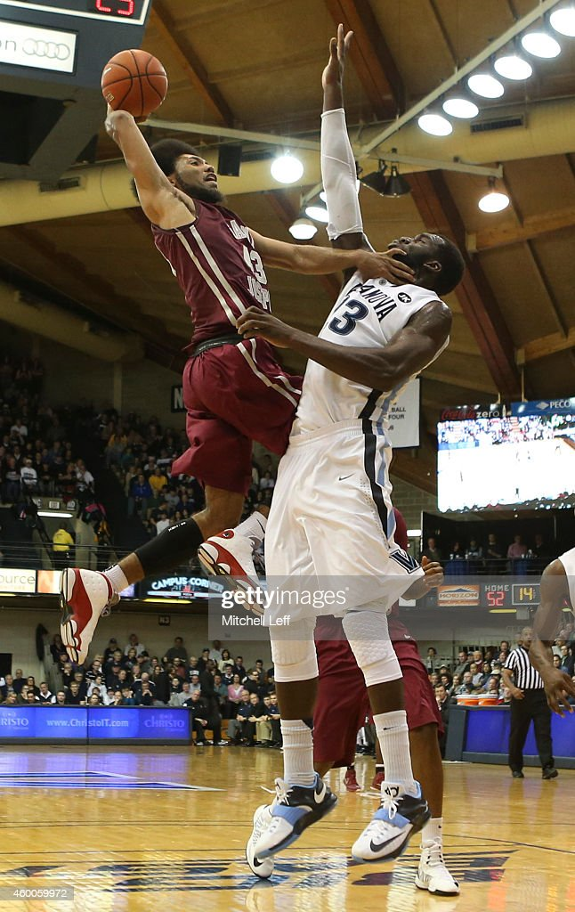 DeAndre Bembry #43 of the Saint Joseph's Hawks attempts a dunk but <a gi-track='captionPersonalityLinkClicked' href=/galleries/search?phrase=Daniel+Ochefu&family=editorial&specificpeople=9986325 ng-click='$event.stopPropagation()'>Daniel Ochefu</a> #23 of the Villanova Wildcats fouls Bembry on the play on December 6, 2014 at the Pavilion in Villanova, Pennsylvania. The Wildcats defeated the Hawks 74-46