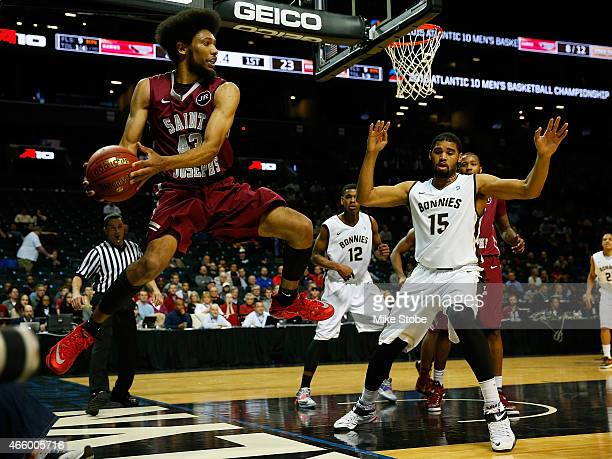 DeAndre Bembry of the Saint Joseph's Hawks attempts to save the ball from going out of bouds against the St Bonaventure Bonnies during the Second...