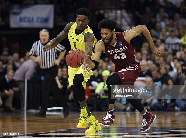DeAndre Bembry of the Saint Joseph's Hawks drives against Jordan Bell of the Oregon Ducks in the first half during the second round of the 2016 NCAA...