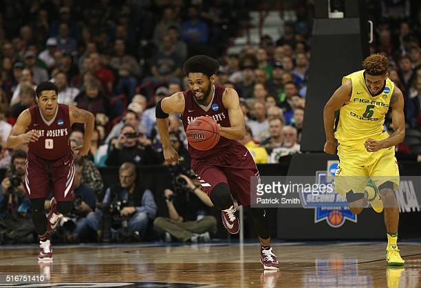 DeAndre Bembry of the Saint Joseph's Hawks drives up court against Tyler Dorsey of the Oregon Ducks in the first half during the second round of the...