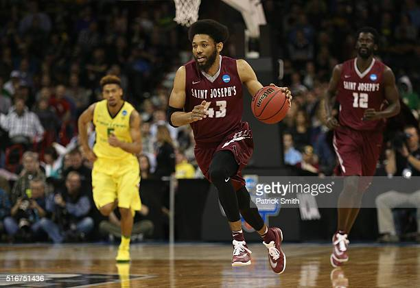 DeAndre Bembry of the Saint Joseph's Hawks drives up court against the Oregon Ducks in the first half during the second round of the 2016 NCAA Men's...