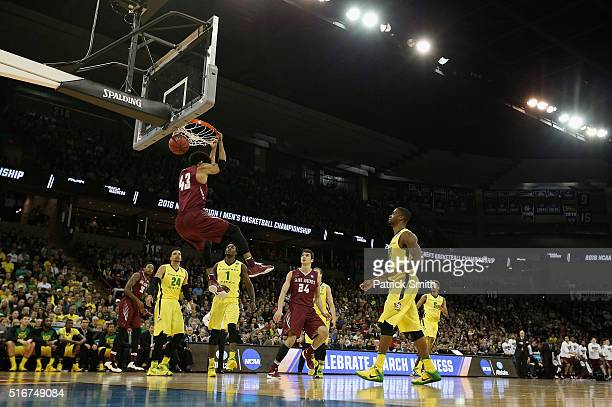 DeAndre Bembry of the Saint Joseph's Hawks goes up with a reverse dunk against hte Oregon Ducks in the first half during the second round of the 2016...