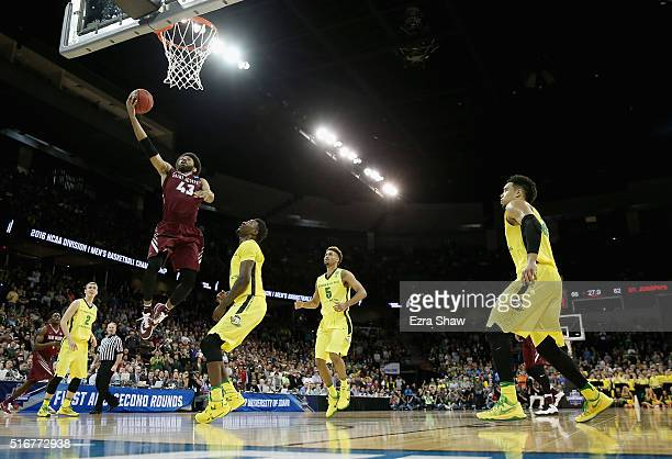 DeAndre Bembry of the Saint Joseph's Hawks shoots against Jordan Bell of the Oregon Ducks in the second half during the second round of the 2016 NCAA...