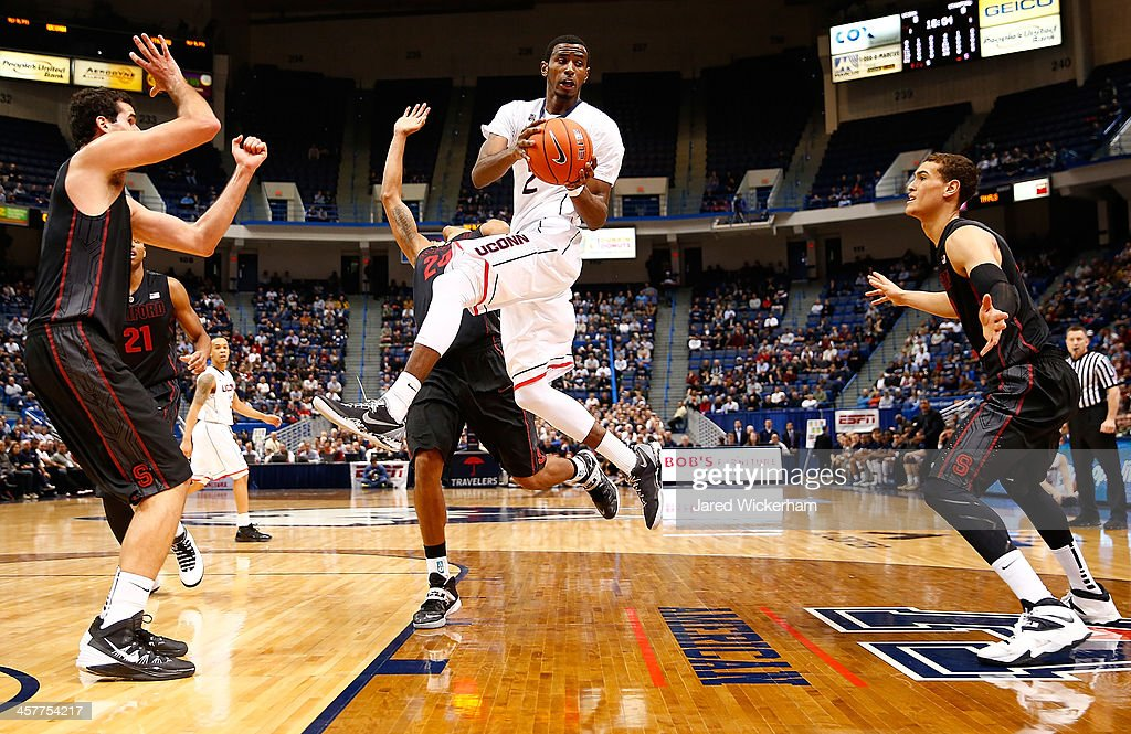 DeAndre Daniels of the Connecticut Huskies passes the ball midair against the Stanford Cardinal in the first half during the game at XL Center on...