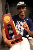 DeAndre Daniels of the Connecticut Huskies poses with the trophy in the locker room after defeating the Kentucky Wildcats 6054 in the NCAA Men's...