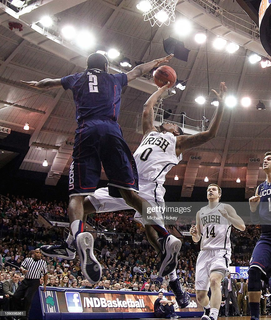DeAndre Daniels #2 of the Connecticut Huskies reaches over to block the shot of <a gi-track='captionPersonalityLinkClicked' href=/galleries/search?phrase=Eric+Atkins&family=editorial&specificpeople=7379862 ng-click='$event.stopPropagation()'>Eric Atkins</a> #0 of the Notre Dame Fighting Irish at Purcel Pavilion on January 12, 2013 in South Bend, Indiana. Connecticut defeated Notre Dame 65-58.