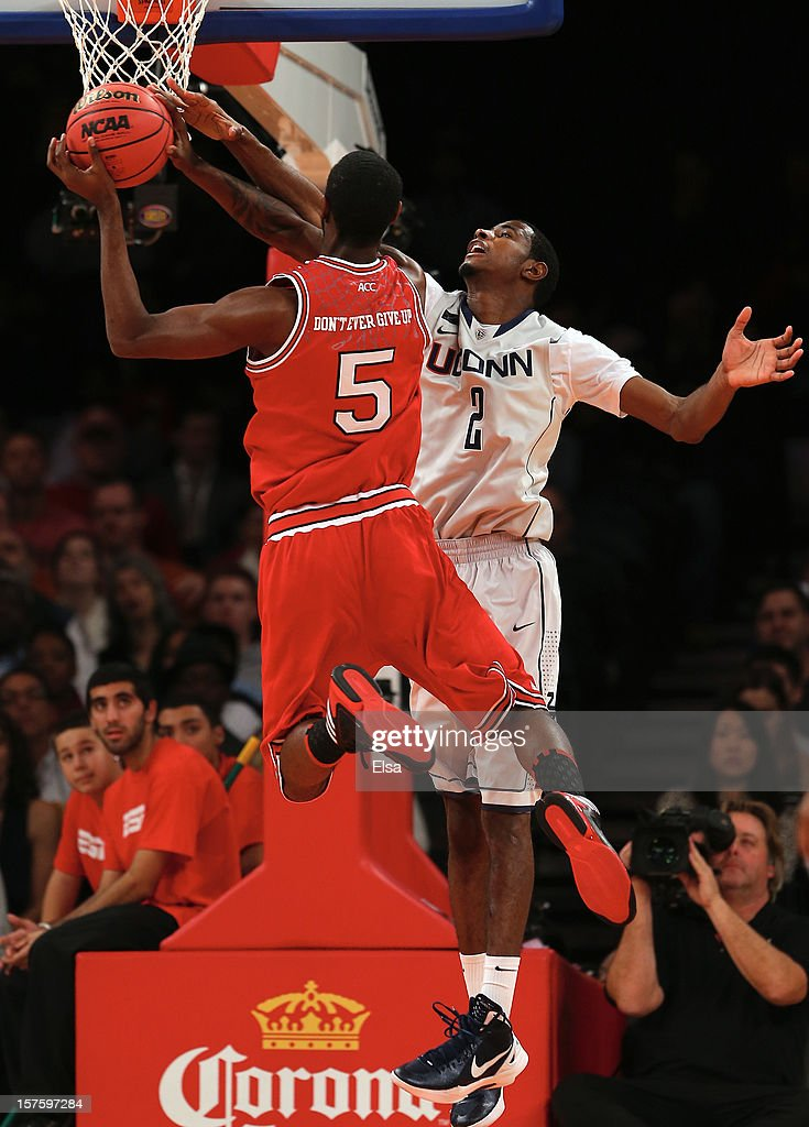 DeAndre Daniels #2 of the Connecticut Huskies tries to block a shot from C.J. Leslie #5 of the North Carolina State Wolfpack during the Jimmy V Classic on December 4, 2012 at Madison Square Garden in New York City.