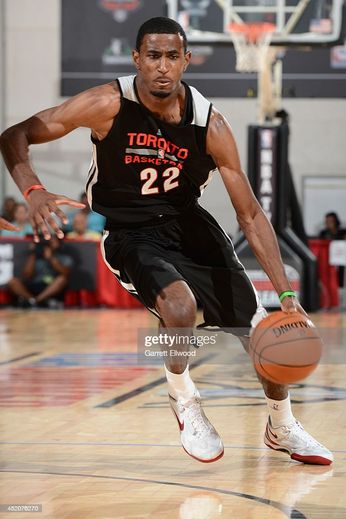 <a gi-track='captionPersonalityLinkClicked' href=/galleries/search?phrase=DeAndre+Daniels&family=editorial&specificpeople=8607612 ng-click='$event.stopPropagation()'>DeAndre Daniels</a> #22 of the Toronto Raptors handles the ball against the Denver Nuggets at the Samsung NBA Summer League 2014 on July 12, 2014 at the Cox Pavilion in Las Vegas, Nevada.