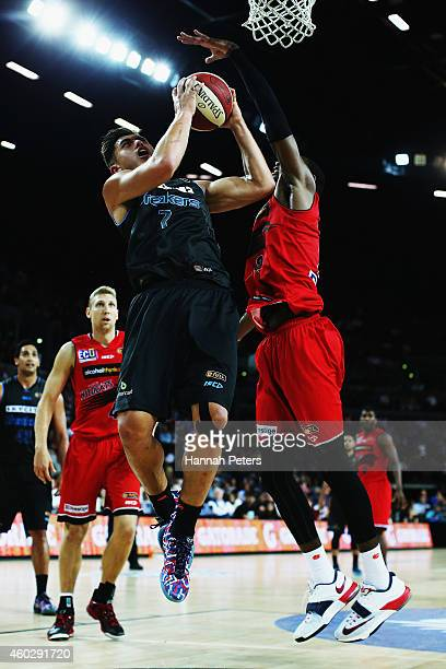 Deandre Daniels of the Wildcats defends over the top of Reuben Te Rangi of the Breakers during the round 10 NBL match between the New Zealand...