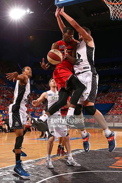DeAndre Daniels of the Wildcats drives to the basket against Daniel Kickert of United during the round five NBL match between the Perth Wildcats and...