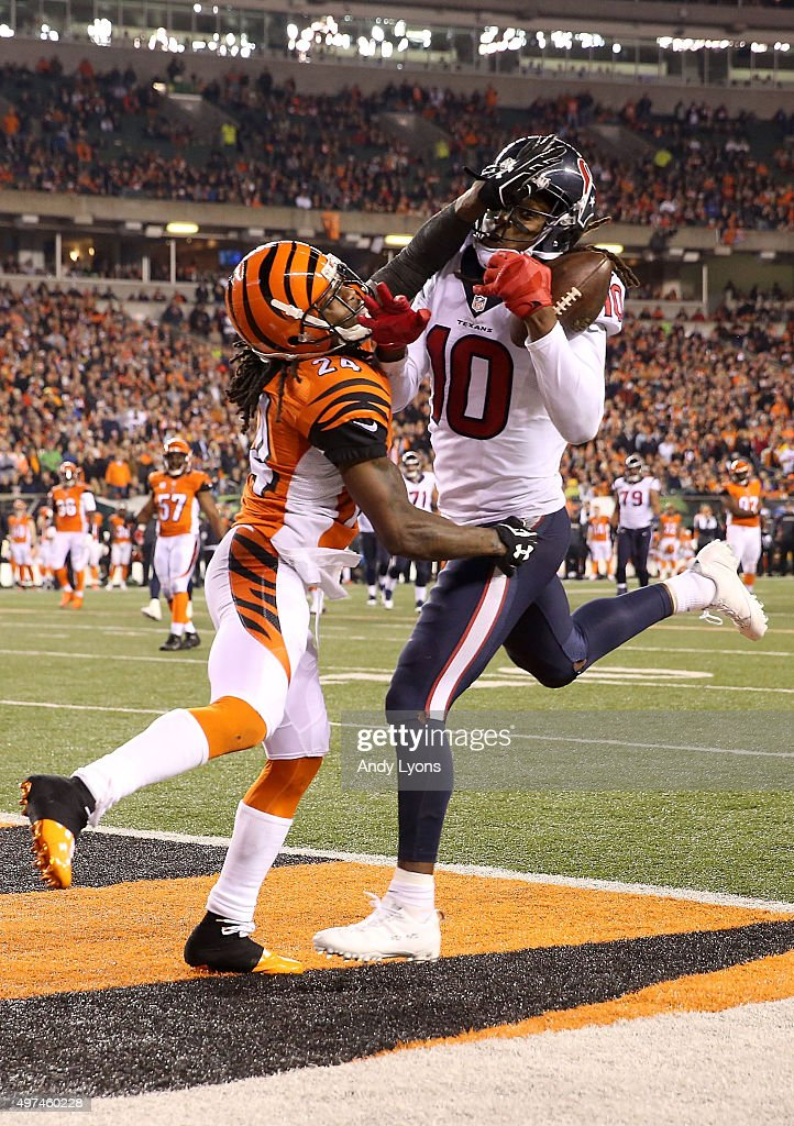 DeAndre Hopkins of the Houston Texans catches a pass for a touchdown while being defended by Adam Jones of the Cincinnati Bengals during the fourth...