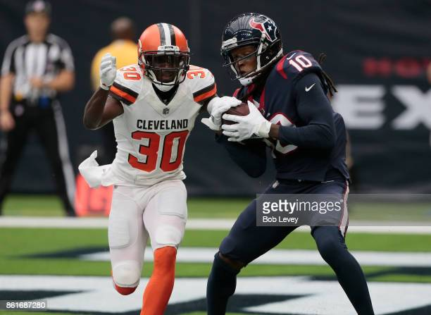 DeAndre Hopkins of the Houston Texans catches a touchdown pass defended by Jason McCourty of the Cleveland Browns in the third quarter at NRG Stadium...