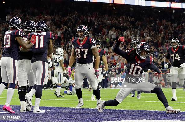 DeAndre Hopkins of the Houston Texans celebrates after a touchdown by CJ Fiedorowicz of the Houston Texans in the fourth quarter during the NFL game...