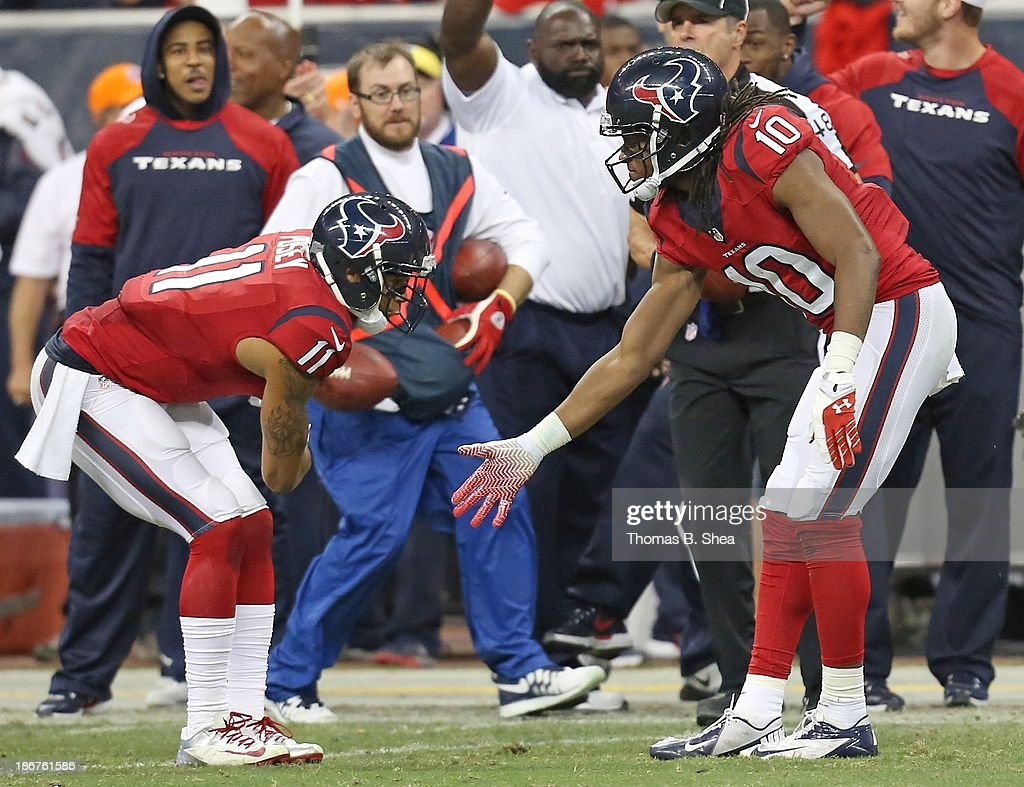 <a gi-track='captionPersonalityLinkClicked' href=/galleries/search?phrase=DeAndre+Hopkins&family=editorial&specificpeople=7321907 ng-click='$event.stopPropagation()'>DeAndre Hopkins</a> #10 of the Houston Texans celebrates his catch with <a gi-track='captionPersonalityLinkClicked' href=/galleries/search?phrase=DeVier+Posey&family=editorial&specificpeople=5571641 ng-click='$event.stopPropagation()'>DeVier Posey</a> #11 of the Houston Texans against the Indianapolis Colts November 03, 2013 at Reliant Stadium in Houston, Texas. Colts won 27 to 24.