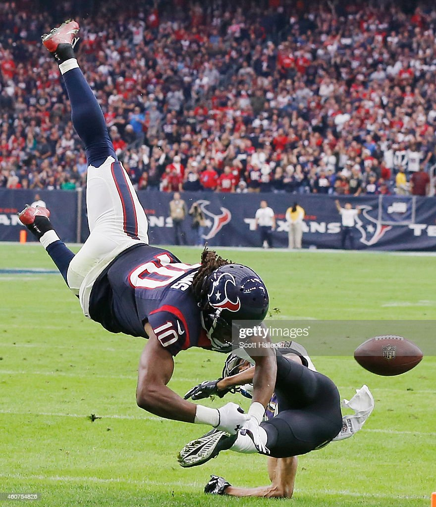 DeAndre Hopkins #10 of the Houston Texans is tackled by Rashaan Melvin #38 of the Baltimore Ravens during the game at NRG Stadium on December 21, 2014 in Houston, Texas.