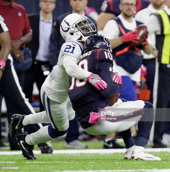 DeAndre Hopkins of the Houston Texans is tackled by Vontae Davis of the Indianapolis Colts in the fourth quarter during the NFL game between the...