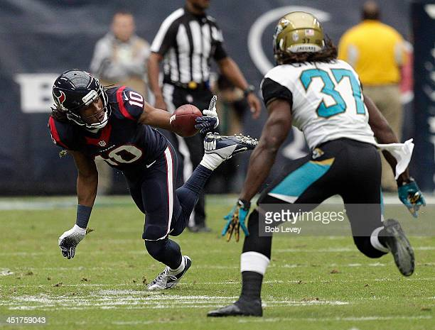 DeAndre Hopkins of the Houston Texans regains control of the ball as Johnathan Cyprien of the Jacksonville Jaguars moves in for the tackle at Reliant...
