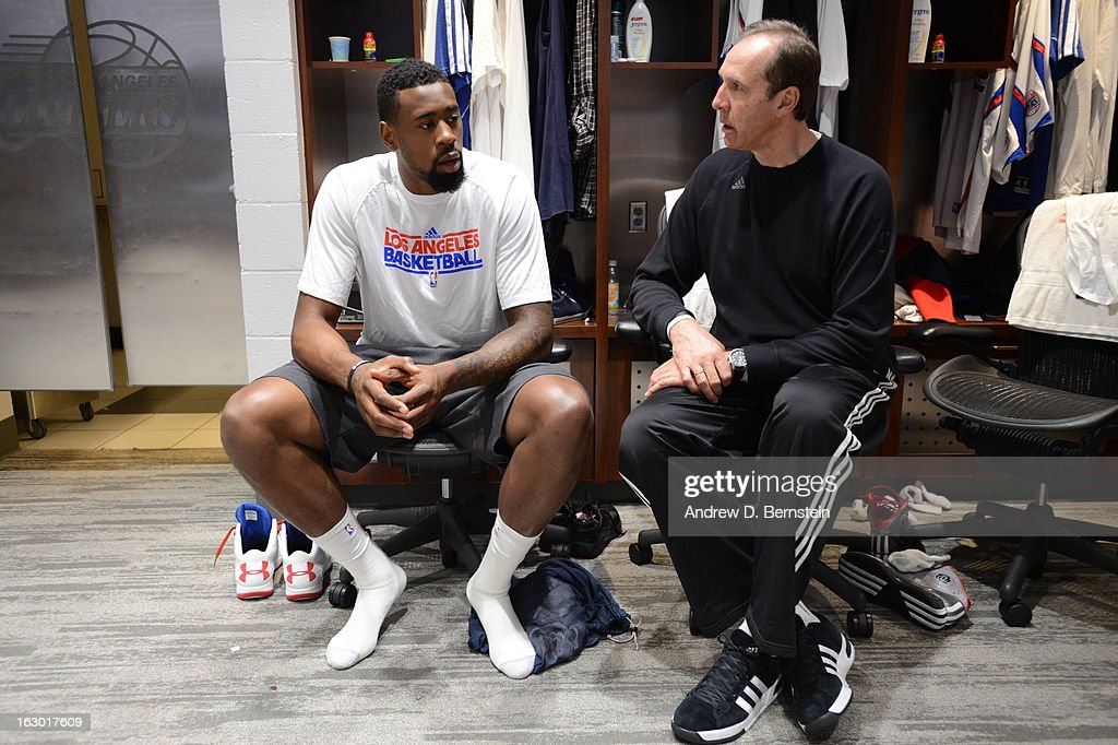 DeAndre Jordan #6 and assistant coach Marc Iavaroni sit in the locker room before facing the Oklahoma City Thunder at Staples Center on March 3, 2013 in Los Angeles, California.