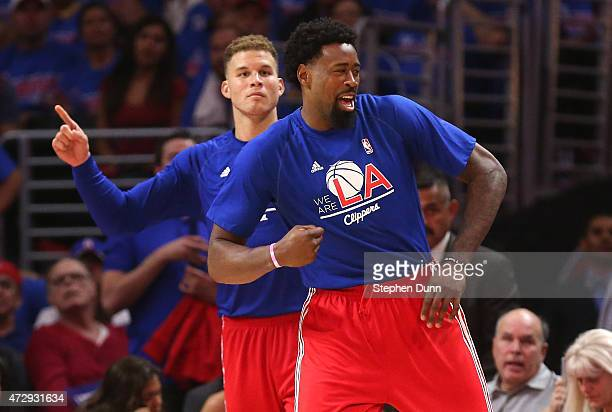 DeAndre Jordan and Blake Griffin of the Los Angeles Clippers celebrate from the bench as they sit out the closing minutes of the fourth quarter...