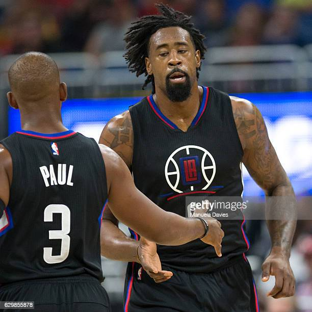DeAndre Jordan and Chris Paul of the LA Clippers celebrate a basket against the Orlando Magic at Amway Center on December 14 2016 in Orlando Florida...