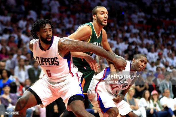 DeAndre Jordan and Jamal Crawford of the Los Angeles Clippers box out Rudy Gobert of the Utah Jazz during the second half of Game Seven of the...