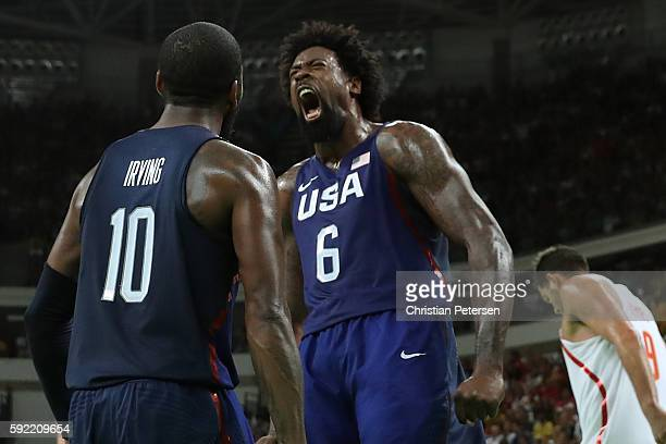 DeAndre Jordan and Kyrie Irving of United States celebrate a Jordan dunk against Spain during the Men's Semifinal match on Day 14 of the Rio 2016...