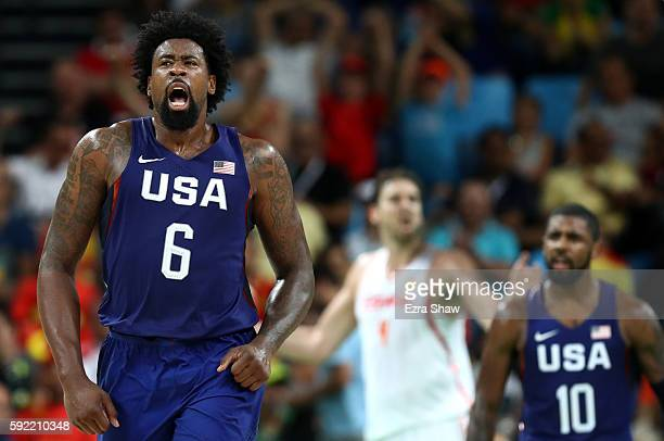 DeAndre Jordan and Kyrie Irving of United States celebrate a Jordan dunk as Pau Gasol of Spain looks on during the Men's Semifinal match on Day 14 of...