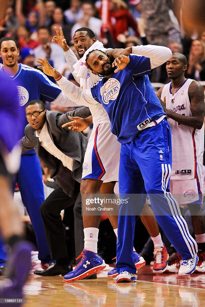 DeAndre Jordan #6 and Ronny Turiaf #21 of the Los Angeles Clippers celebrate from the sideline during a game against the Sacramento Kings at Staples Center on December 21, 2012 in Los Angeles, California.