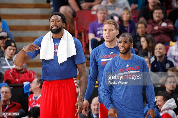 DeAndre Jordan Blake Griffin and Chris Paul of the Los Angeles Clippers cheer on their teammates against the Sacramento Kings on January 17 2015 at...