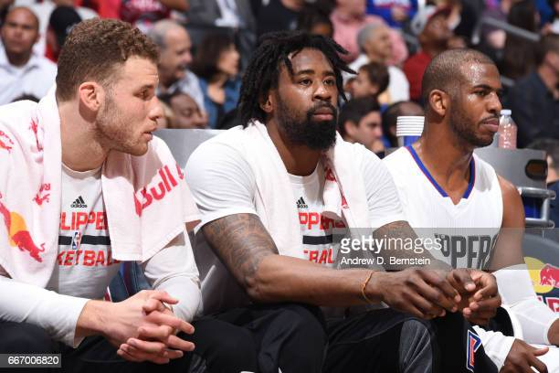 DeAndre Jordan Blake Griffin and Chris Paul of the Los Angeles Clippers look on during the game against the Washington Wizards on March 29 2017 at...