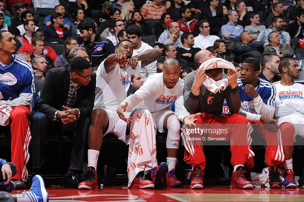 DeAndre Jordan #6 ; Caron Butler #5 and Blake Griffin #32 of the Los Angeles Clippers have some fun while watching the game against the Charlotte Bobcats at Staples Center on February 26, 2013 in Los Angeles, California.