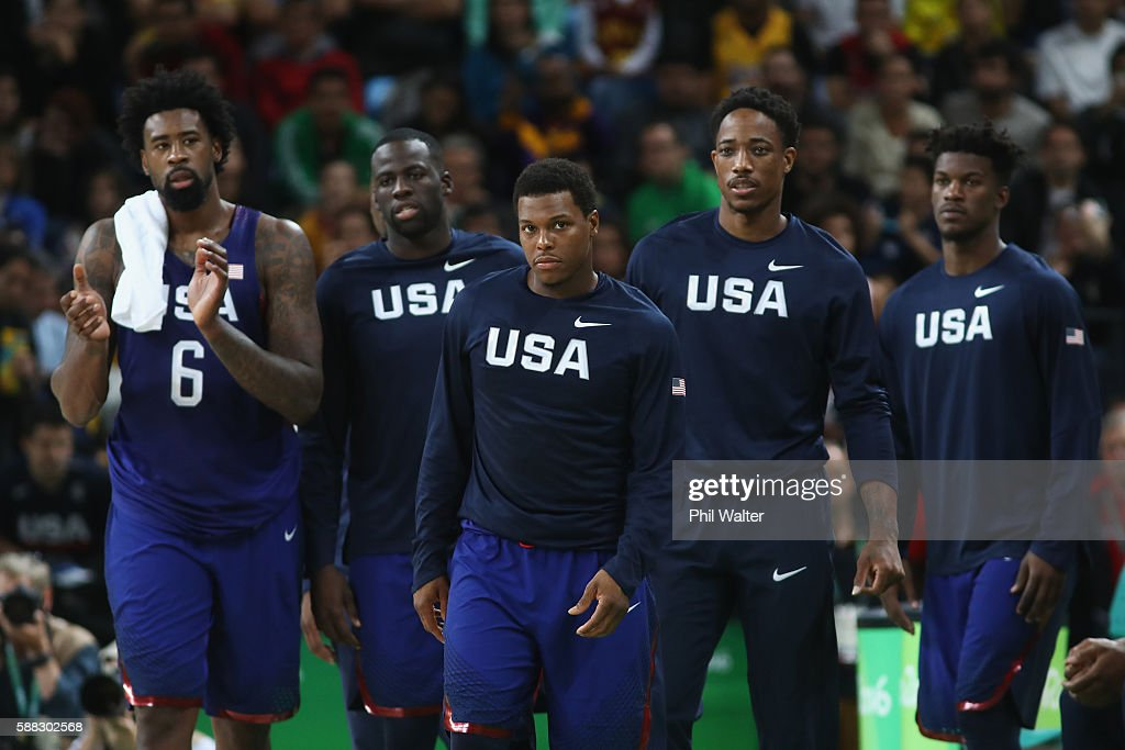 DeAndre Jordan #6, Draymond Green #14, Kyle Lowry #7, Demar DeRozan #9 and Jimmy Butler #4 of United States react during the Men's Preliminary Round Group A between Australia and the United States on Day 5 of the Rio 2016 Olympic Games at Carioca Arena 1 on August 10, 2016 in Rio de Janeiro, Brazil.