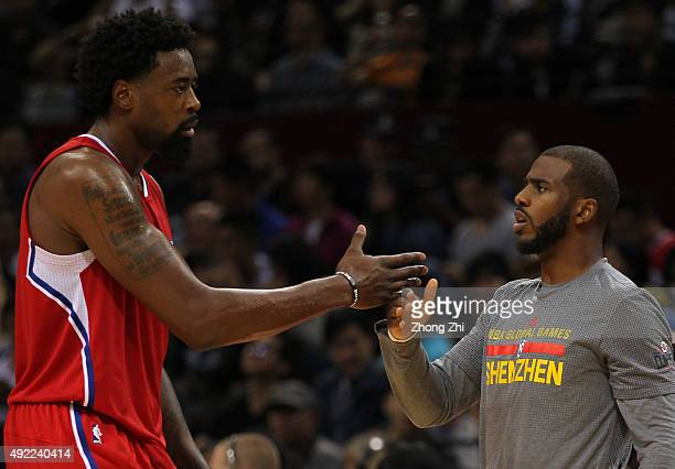 Deandre Jordan of Los Angeles Clippers cheers with Chris Paul of Los Angeles Clippers during the match between Charlotte Hornets and Los Angeles...