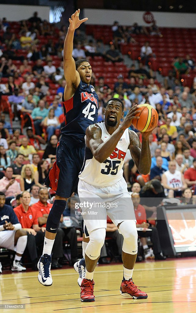 DeAndre Jordan #35 of the 2013 USA Basketball Men's National Team grabs the ball as Anthony Davis #42 of the 2013 USA Basketball Men's National Team defends during a USA Basketball showcase at the Thomas & Mack Center on July 25, 2013 in Las Vegas, Nevada.