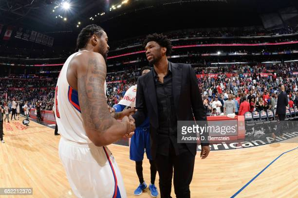 DeAndre Jordan of the LA Clippers and Joel Embiid of the Philadelphia 76ers talk after a game on March 11 2017 at STAPLES Center in Los Angeles...