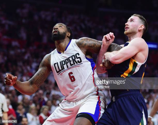 DeAndre Jordan of the LA Clippers fends off Gordon Hayward of the Utah Jazz for a rebound during a 9795 Jazz win at Staples Center on April 15 2017...