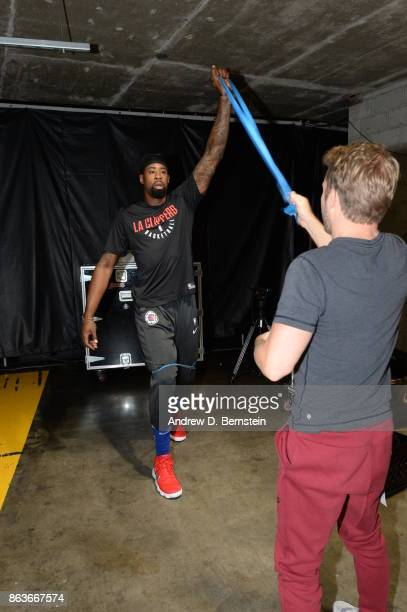 DeAndre Jordan of the LA Clippers stretches before the game against the Los Angeles Lakers on October 19 2017 at STAPLES Center in Los Angeles...