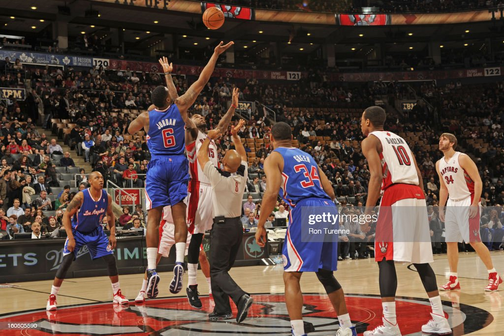 <a gi-track='captionPersonalityLinkClicked' href=/galleries/search?phrase=DeAndre+Jordan&family=editorial&specificpeople=4665718 ng-click='$event.stopPropagation()'>DeAndre Jordan</a> #6 of the Los Angeles Clippers and <a gi-track='captionPersonalityLinkClicked' href=/galleries/search?phrase=Amir+Johnson&family=editorial&specificpeople=556786 ng-click='$event.stopPropagation()'>Amir Johnson</a> #15 of the Toronto Raptors jump for the tip off on February 1, 2013 at the Air Canada Centre in Toronto, Ontario, Canada.