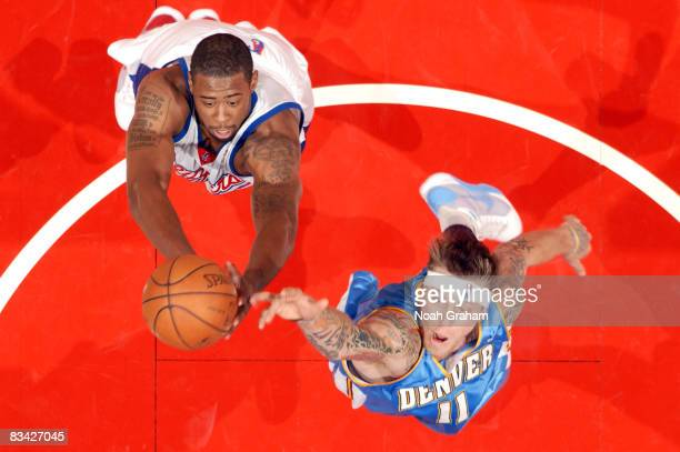 DeAndre Jordan of the Los Angeles Clippers and Chris Andersen of the Denver Nuggets reach for the ball during their game at Staples Center on October...