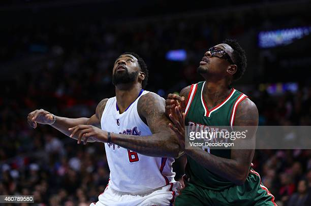 DeAndre Jordan of the Los Angeles Clippers and Larry Sanders of the Milwaukee Bucks vie for position under the baseket during the NBA game at Staples...