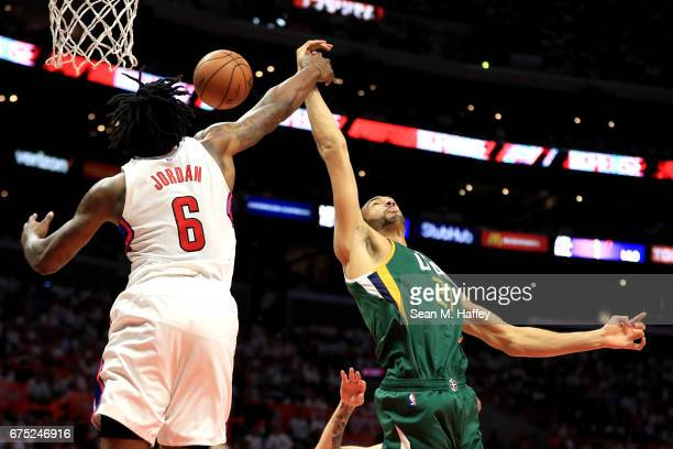 DeAndre Jordan of the Los Angeles Clippers and Rudy Gobert of the Utah Jazz battle for a rebound during the second half of Game Seven of the Western...