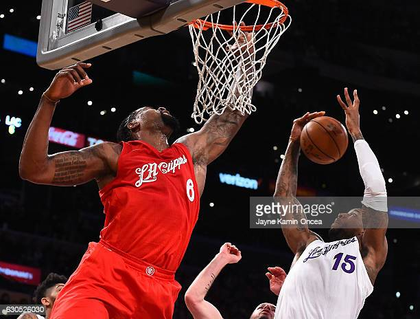 DeAndre Jordan of the Los Angeles Clippers and Thomas Robinson of the Los Angeles Lakers battle for a rebound in the first half of the game at...