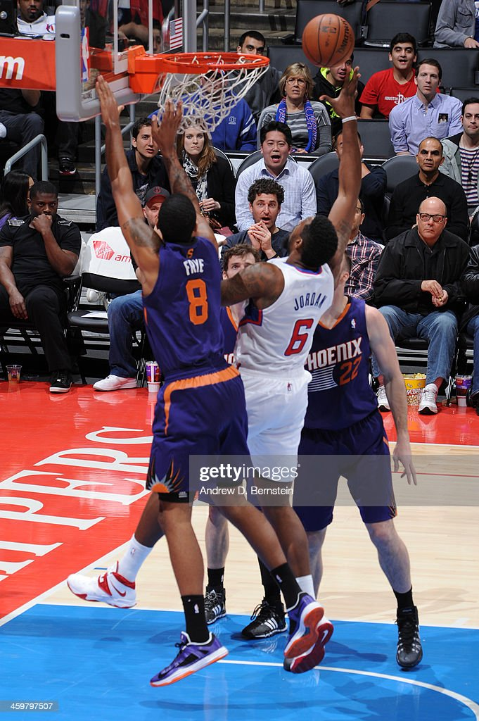 <a gi-track='captionPersonalityLinkClicked' href=/galleries/search?phrase=DeAndre+Jordan&family=editorial&specificpeople=4665718 ng-click='$event.stopPropagation()'>DeAndre Jordan</a> #6 of the Los Angeles Clippers attempts a shot against Channing Frye #8 of the Phoenix Suns at STAPLES Center on December 30, 2013 in Los Angeles, California.