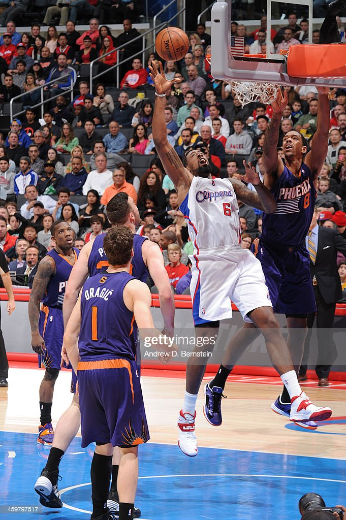 <a gi-track='captionPersonalityLinkClicked' href=/galleries/search?phrase=DeAndre+Jordan&family=editorial&specificpeople=4665718 ng-click='$event.stopPropagation()'>DeAndre Jordan</a> #6 of the Los Angeles Clippers attempts a shot during a game against the Phoenix Suns at STAPLES Center on December 30, 2013 in Los Angeles, California.