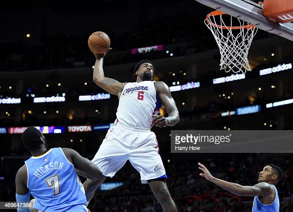 DeAndre Jordan of the Los Angeles Clippers attempts an alleyoop dunk between JJ Hickson and Gary Harris of the Denver Nuggets during a 110103 Clipper...